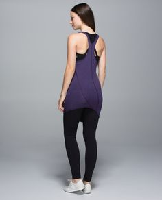 We like our yoga practice (and our tanks) with a twist. We designed this lightweight top with a tight fit and long length to move with us and keep us covered, whether we're right-side-up or upside-down. The racerback cut gives us room to move so we're free to fly, float and bend.  just bought