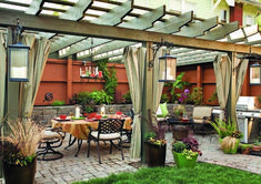 terrace setting, complete with cobblestone patio, stone walls, and rustic pergola.