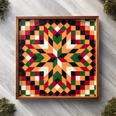 This 2' x 2' wooden barn quilt is handmade with premium cedar wood. The star and patchwork quilt block pattern is created using small individual pieces of cedar wood that are hand painted and lightly distressed. This framed wall hanging is perfect for adding bold color, texture, and design to any wall space in your home. Inspired by traditional quilt square, barn quilts make wonderful statement pieces as well as unique and meaningful gifts. They are timeless pieces of artwork. Barn Quilt Designs, Quilting Designs, Frames On Wall, Framed Wall, Wooden Barn, Handmade Signs, Mosaic Wall Art, Traditional Quilts, Cedar Wood