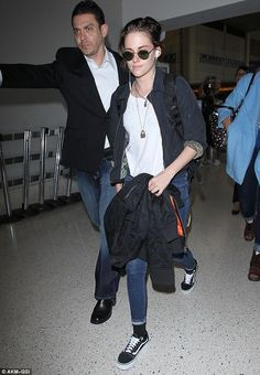 Personal protection: Stewart has been busy flying back and forth between Los Angeles and New York filming her latest film, an unnamed Woody Allen project