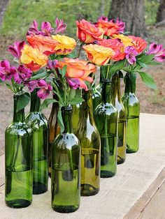 Wedding Flower Arrangements Easy and Elegant Wine Bottle Centerpiece ! - Make an Easy and Elegant Wine Bottle Centerpiece! Perfect for weddings, bridal showers, and parties! Wine Bottle Centerpieces, Floral Centerpieces, Table Centerpieces, Floral Arrangements, Centerpiece Ideas, Wine Bottle Vases, Summer Centerpieces, Bridal Shower Centerpieces, Wine Bottle Decorations