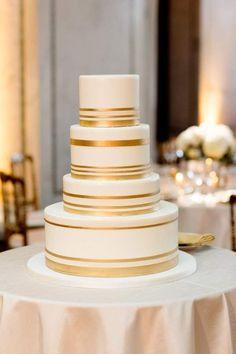 Minimalist brides will appreciate simple gold and white stripes on a stately wedding cake @myweddingdotcom