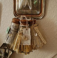 cork & paper tassels, I made about a dozen of these, used old book paper…