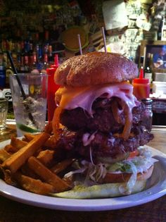 """The """"BEST BURGER JOINT"""" hands down. Well worth the wait, great staff and a bar filled with endless things to look at. Also featured on Man vs Food. Located in historic German Village. Try it if you dare."""