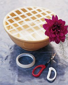 How to arrange flowers in a big bowl. Use sticky tape!