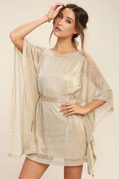 Lulus Exclusive! Get down with your girls in the Ladies' Night Gold Kaftan Dress! Gold speckled, beige knit shapes a bateau neckline and kaftan bodice with wide-cut sleeves, and tying sash at the waist. Mini skirt shows off your stems while you show off your moves!