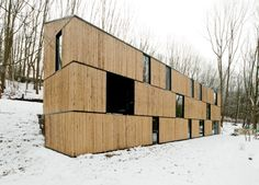 """Residential Architecture: House in Rotselaar by AST 77: """"..designed by by belgian practiceAST 77, the 'house in rotselaar' is nestled within a forested plot in rotselaar, belgium.the 26.3 meter long by 4.5 meter wide dwelling is an open volume which navigates a steep grade. the exterior is clad withbamboo poles framed with black steel structural elements. the facade treatment attempts to recede into the context of tree trunks.strategically placed windows offer outward views and increase…"""