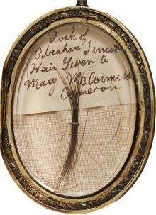 Extremely Rare Lock of Abraham Lincoln's Hair Housed in a Beautifully Engraved Gold Locket obtained by Mary McCormick Cameron, the daughter-in-law of Simon Cameron, Abraham Lincoln's first Secretary of War and political ally. Simon Cameron remained a close friend of Mary Lincoln after the President's death and helped her to undertake a campaign to raise money to meet the mountains of debts Mary had accumulated.