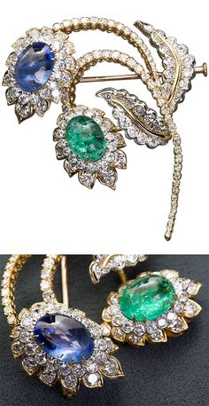 An Unusual David Webb Emerald Sapphire Diamond Double Flower Spray Brooch. A diamond in 18k yellow gold flower brooch with one large cabochon emerald and cabochon sapphire by David Webb.