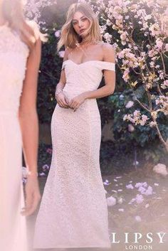 Womens Lipsy Bridal Lace Bardot Maxi Dress. Make a stunning entrance on your special day with this gorgeous dress from Lipsy. Adorned with lace and an on-trend bardot neckline. Simply team it with a pair of embellished heels and a statement neck-piece to complete the look. {affiliate link} #bridalgown #weddingdress #bardotweddingdress