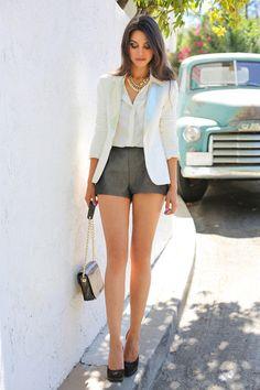 Tuxedo blazer, button-up blouse, shorts, and pumps.
