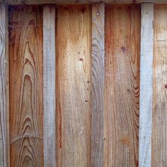 Larch board and batten cladding weathered for 18 months.
