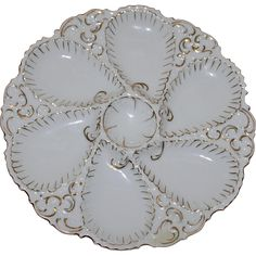 Here is an actual oyster plate once used on the Pennsylvania Railroad Dining Service. It is a 6 well oyster plate with a center sauce well. All the