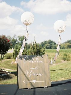 Decorate the wedding reception with tasseled, confetti-filled geronimo balloons so guests won't miss the entrance from the road. {Krista A. Jones Photography}