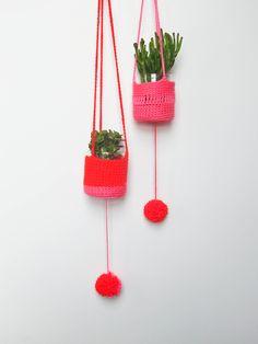 Brightly colored crochet planters! Cute.