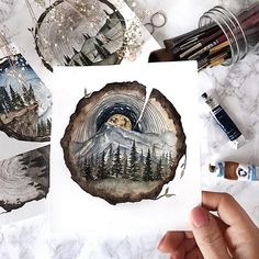 (@rosies.sketchbook) I did another tree stump painting, I left the edges more organic like the previous ones however I did change it up a bit with the scene inside.  #watercolor #watercolour #painting #sketch #art #artist #artwork #draw #drawing #doodle #watercolorist #illustration #illustrate
