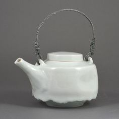 Teapot, Porcelain, pale blue celadon glaze with a delicate crackle, mounted with a twisted looping silver metal handle, impressed maker's mark