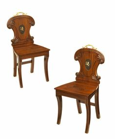 A Unusual Pair of Regency Hall Chairs. English, Circa The chairs have particularly interesting backs with an ormolu handle and a painted crest depicting a demi lion rampant holding a rose. The solid seat on reeded sabre legs. Types Of Furniture, Art Furniture, Antique Furniture, Side Chairs, Hall Chairs, Regency House, Regency Era, Regency Furniture, Antique Chairs