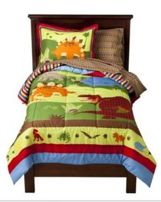 Bright Colored Dinosaurs Boys Twin Comforter Set (5 Piece Bed In A Bag) by Kreative Kids. $89.99. The set includes: 1- TWIN Size Comforter, 1- Flat Sheet, 1-  Fitted Sheet, 1- Pillowcase & 1- Pillow Sham.. A roaring good time. Your little one will love this dinosaur bedding.  The set includes: 1- TWIN Size Comforter, 1- Flat Sheet, 1-  Fitted Sheet, 1- Pillowcase & 1- Pillow Sham.