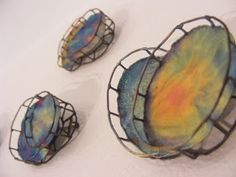 This product has railing at the fringe of them and shaped round. Several different colors are mixed in pastel texture.
