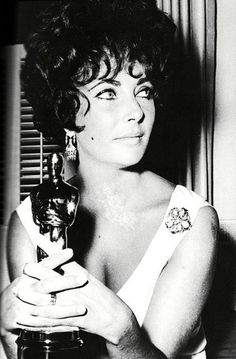 """Elizabeth Taylor with her Oscar for her performance in """"BUtterfield 8,"""" 1961"""