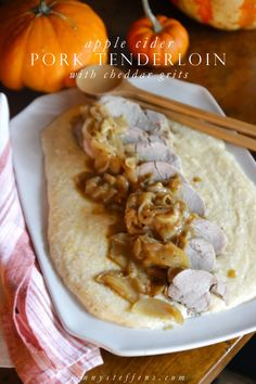 Apple Cider Pork Tenderloin  with Cheddar Grits  - So easy and simple.  Only 45 minutes in the oven!