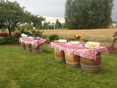 Tables set up for a Maine lobster and clambake rehearsal dinner event.