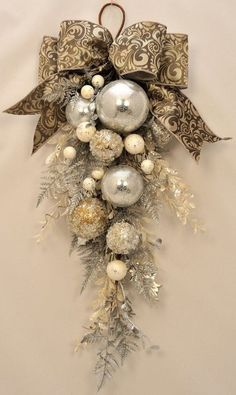 This stunning holiday swag is created with a sparkling combination of shiny silver and glittering silver, gold and platinum ornaments. Description from pinterest.com. I searched for this on bing.com/images