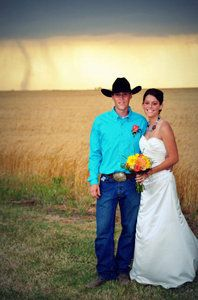 Photographer Cate Eighmey photographed newlyweds Caleb and Candra Pence with a tornado in the background in Harper County, Kansas on Saturday, May 19, 2012.