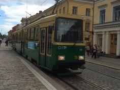 The No 4 Tram passing by Helsinki Cathedral in Helsinki Senate Square.  Trams are the most efficient mode of public transportation in Helsinki.  #travel #finland #scandinavia #europe #helsinki #suomi #transit #tram #nordic