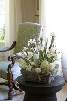 Some seasonal favorites including hyacinths and tulips breathe life into a woodland-style design with lichen-covered branches.  | Arrangement by Ray Jordan and Janet Jackson | Photo by Becky Luigart-Stayner
