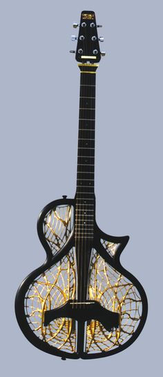 "Chrysalis #Guitar Interesting travel guitar that breaks down into about 1/8th the volume of an acoustic guitar. There are some modular components like the neck, headstock, bridge, and the ""grill"" that fills the body frame."