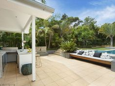 An in built cushioned bench is perfect for enjoying a drink from the outdoor bar, a cup of...
