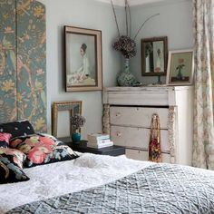 Divide width of bed into an odd #. Acquire that # of boards (where the width of the boards x that # = the width of the bed). Cover front in heavy  batting or thin foam or nothing. Then staple gun on some fabric!