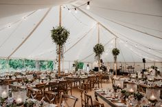 Beautiful centre poles and festoon lighting with natural matting and wooden cross back chairs around rectangular farm house tables Family Events, Perfect Party, Farmhouse Table, Corporate Events, Farm House, Tablescapes, Party Planning, Tent, Chairs
