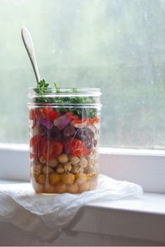 Mason jar salad - pour the dressing in first then shake when you're ready to eat - keeps your salad from becoming soggy!
