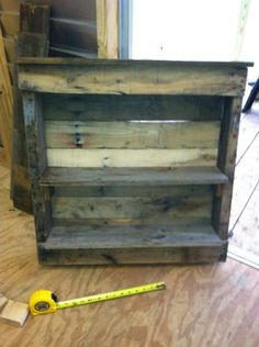 A cute shelf made from a small pallet.