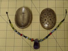 Norse garb - turtle brooches made from Femo clay with embedded pins, and strung beads with amethyst pendant to hang from them