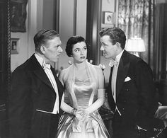 "Leo G. Carroll, Ruth Roman and Robert Walker in ""STRANGERS ON A TRAIN"" (1951)."