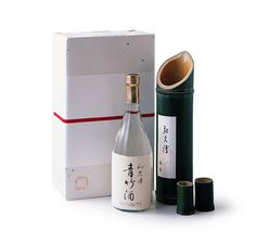 A sake bottle packed in a bamboo log with bamboo sake cups as a gift set