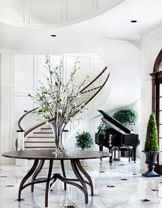 Beautifully designed #home foyer with #marble floors & a black grand #piano.