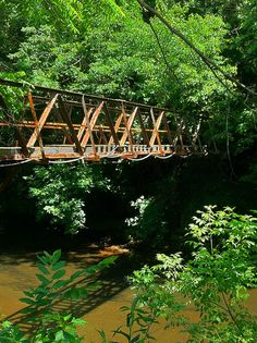 This foot bridge crosses the Bluestone River in Bramwell WV. It connected to a piece of land where Coal Baron I.T. Mann built his children a 'small' playhouse. This playhouse was larger than many people's homes!