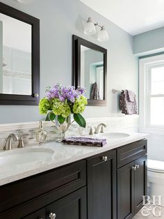 The 12 Best Bathroom Paint Colors Our Editors Swear By - blue-gray bathroom walls with black vanity and mirrors - Best Bathroom Paint Colors, Gray Bathroom Walls, Bathroom Color Schemes, Bathroom Renos, Grey Bathrooms, Beautiful Bathrooms, Master Bathroom, Bathroom Ideas, Bathroom Cabinets