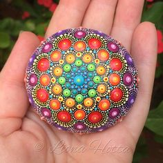 This is Rainbow dotted Mandala Stone I made with precision and joy (and acrylic paint and very tiny brushes of course). I have enjoyed very much creating it and happy to put it out there for you to fall in love with it too. The stone itself I got from the Kirikos island, Greece and was sent to me by Nik - check his shop here in Etsy: https://www.etsy.com/es/shop/ThermalStoneDesign. It is approx. 6 cm. diameter and it is sealed with matt varnish. It is suitable for ind...
