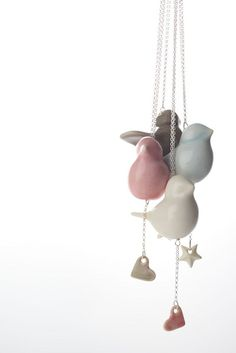 the taupe coloured one because it's just so darn cute... !: Bird necklace ~ me me me