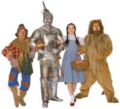 Follow, follow, follow, follow, follow the yellow brick road! Dorothy (Maeve Coleen Moynihan), Scarecrow (Dean Holt), Lion (Reed Sigmund) and the Tin Man (Max Wojtanowicz) in Children's Theatre Company's 2011-2012 production of The Wizard of Oz. Photo by Joan Buccina.
