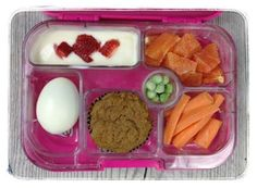 Here is my 9-year-old's school lunch today! She got plain yogurt mixed with a little pure maple syrup and strawberries, orange slices, carrots, frozen peas, whole-wheat carrot/applesauce muffin, and a hard boiled egg. I used her new Yumbox.