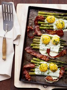 Local bacon and eggs over asparagus. A great way to start the day or add to it! www.redmeatmarket.com