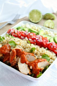 Spicy Kasundi Chicken Salad Bowls. Grilled Chicken topped with Wozz Spicy Tomato Kasundi Sauce layered with cilantro lime couscous, cherry tomatoes, avocados and feta cheese. Recipe online @ http://www.wozzkitchencreations.com/products/kasundi-chicken-bowls