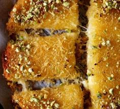 Knafeh bil Jibne - which is extremely popular dessert in Arabic region. Egyptian Food, Egyptian Recipes, Arabic Recipes, Just Desserts, Dessert Recipes, Arabian Food, Caramelized Bananas, Lebanese Recipes, Middle Eastern Recipes